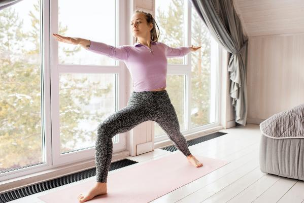 A woman performing yoga at home