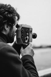 Man with old fashioned video camera
