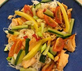An image relating to Hot smoked salmon and mango noodle bowl