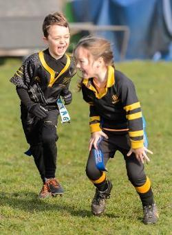 Two children tag rugby