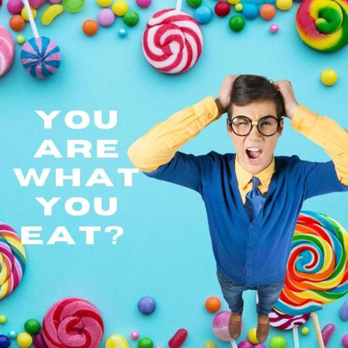 Teenager holding his head with a blue background and lots of images of different coloured sweets