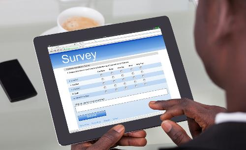 Photo of someone doing a survey on tablet