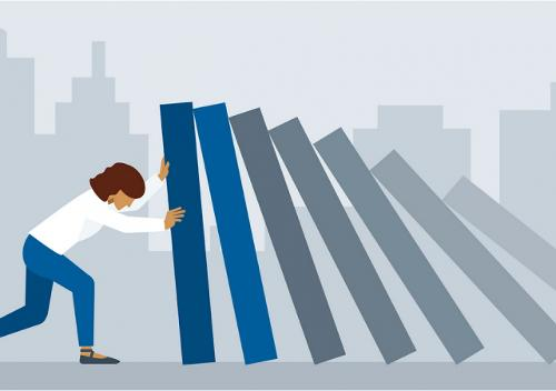 Person pushing against a stack of falling blocks image